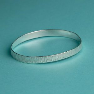 Wide Hammered Bangle with bark effect texture