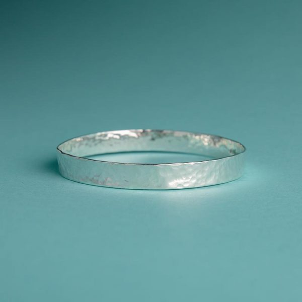 Handmade Silver Hammered Wide Bangle with Subtle Texture by Corzo & Wood