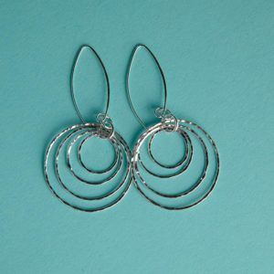 Hammered multi-circle earrings on a long wire handmade by Corzo and Wood