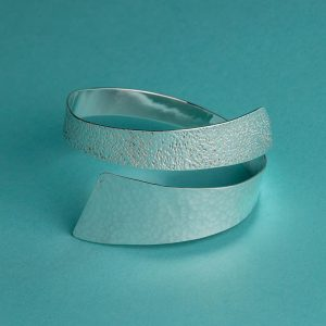 Hammered Wide Oval Bangle with contrasting textures