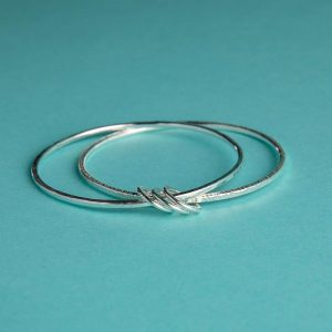 Duo of linked hammered bangles