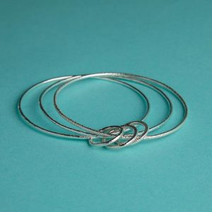 Handmade Silver Trio of Hammered Bangles with 3 Hammered Rings by Corzo & Wood