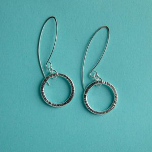 Hammered circle earrings on a long wire handmade by Corzo and Wood
