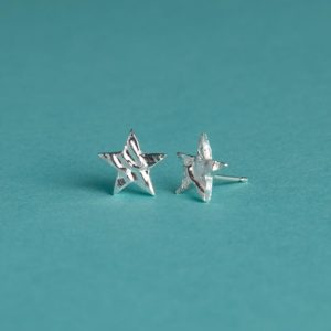 Medium textured star stud earrings handmade by Corzo and Wood