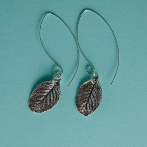 Real rose leaf earrings on a long wire handmade by Corzo and Wood