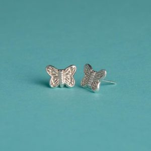 Small textured butterfly stud earrings handmade by Corzo and Wood