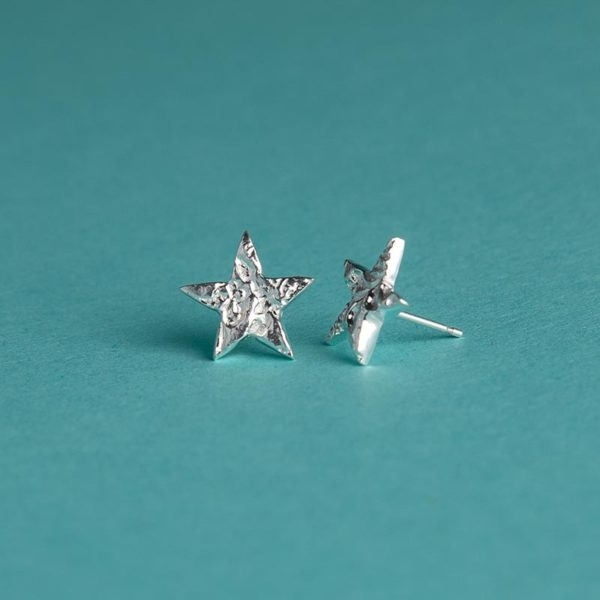 Small textured star stud earrings handmade by Corzo and Wood