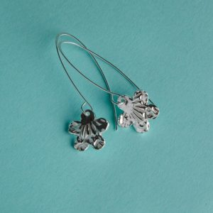 Textured flower earrings on a long wire handmade by Corzo and Wood