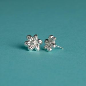 Small textured flower stud earrings handmade by Corzo and Wood