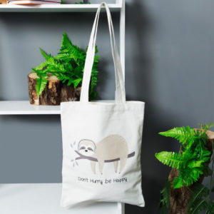 Canvas sloth shopper sold by Corzo and Wood